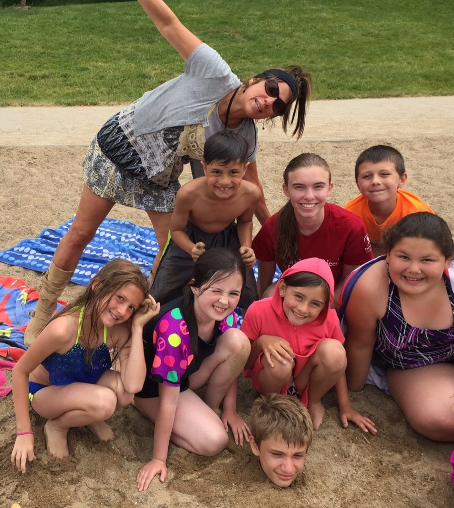 Dodge Nature Center Naturalist Pam Welisevich and her Fish and Swim campers on the beach.