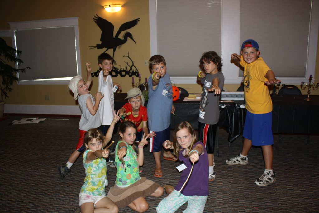 At Dodge Nature Center's Dodgewarts camp, witches and wizards show off their handmade wands.
