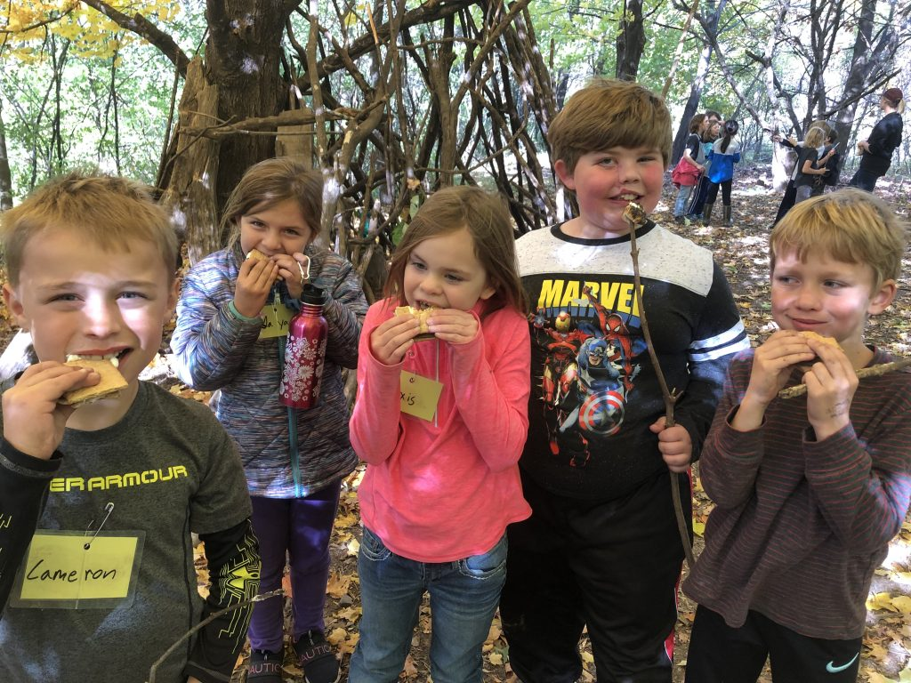 Dodge Nature Center campers dig into their fire-roasted sweet treats, s'mores!